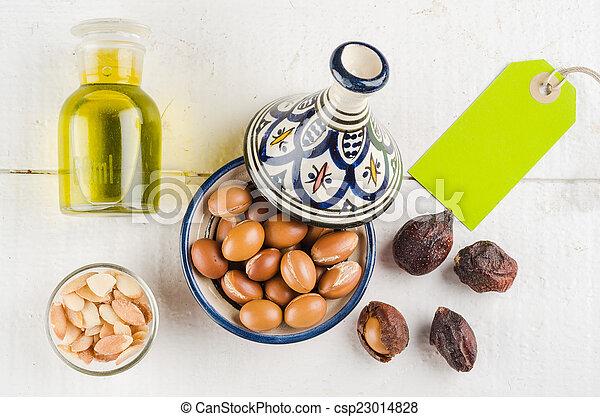 Argan fruit in a moroccan tajine - csp23014828