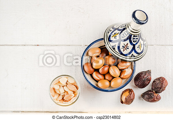 Argan fruit in a moroccan tajine - csp23014802