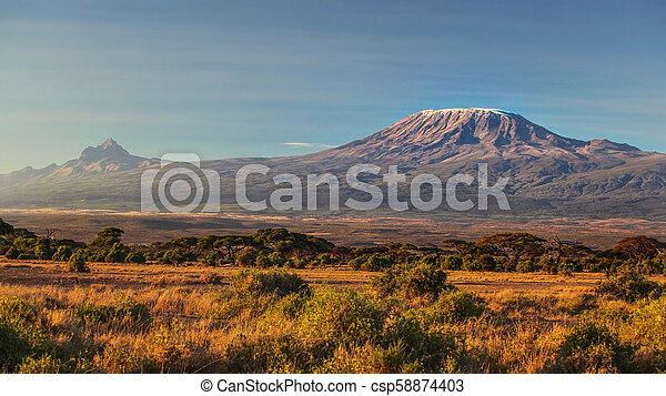 arid dry African savanna in late evening with Mount Kilimanjaro, highest peak i Africa. Amboseli National Park, Kenya - csp58874403