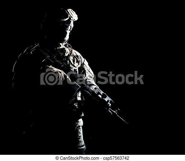 Armed infantryman during night military operation - csp57563742