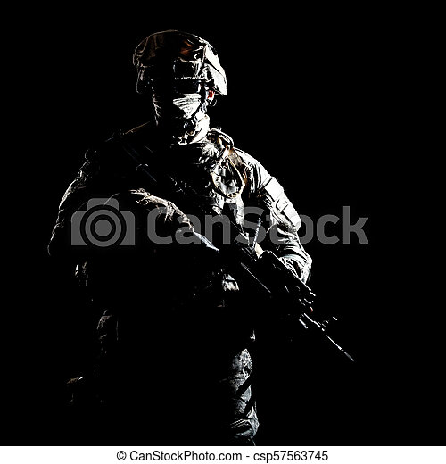 Armed infantryman during night military operation - csp57563745