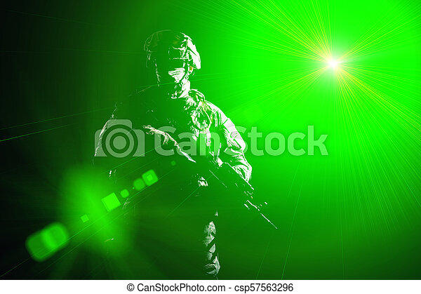 Armed infantryman during night military operation - csp57563296