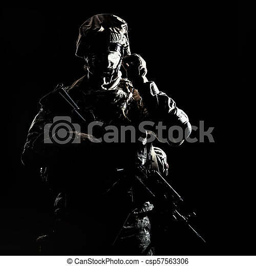 Armed infantryman during night military operation - csp57563306