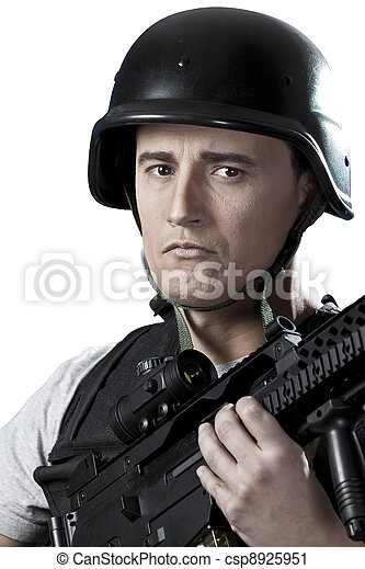 Armed military in protective cask with a weapon - csp8925951