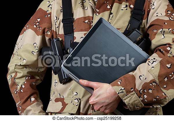 Armed soldier holding modern technology computer  - csp25199258