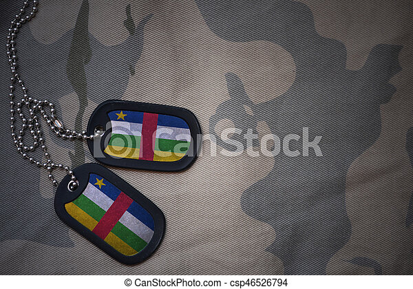 army blank, dog tag with flag of central african republic on the khaki texture background. military concept - csp46526794