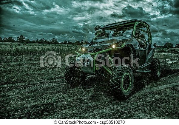 Army rangers moving on military buggy at night - csp58510270