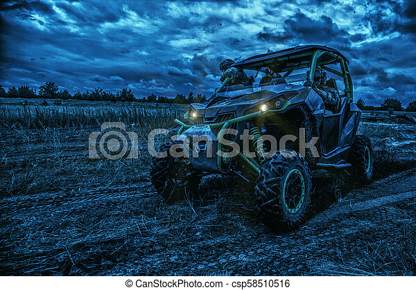 Army rangers moving on military buggy at night - csp58510516