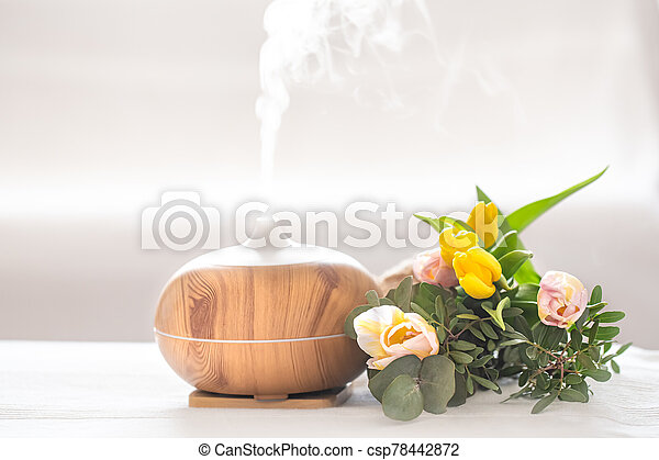 Aroma oil diffuser lamp on the table . - csp78442872