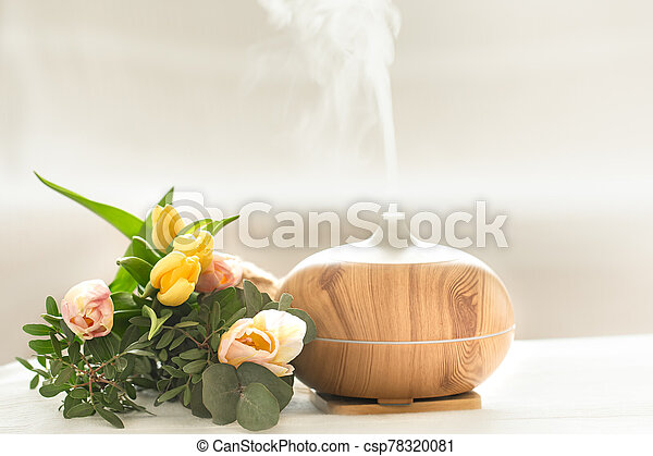 Aroma oil diffuser lamp on the table . - csp78320081
