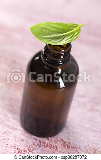 Aromatherapy - Basil essential oil bottle  - csp36287072