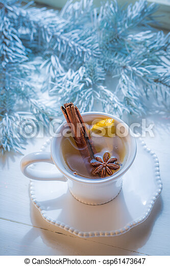 Aromatic and sweet tea with orange and cinnamon for Christmas - csp61473647