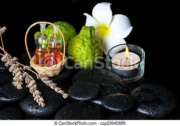 Aromatic spa concept of bottles essential oil, bergamot fruits,  - csp23640889