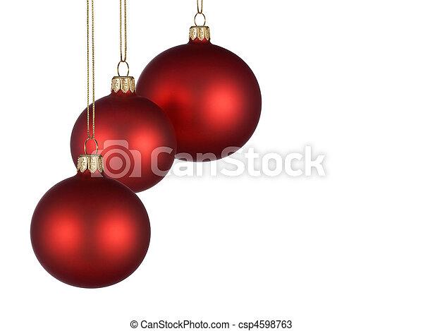 Un arreglo navideño con adornos rojos - csp4598763