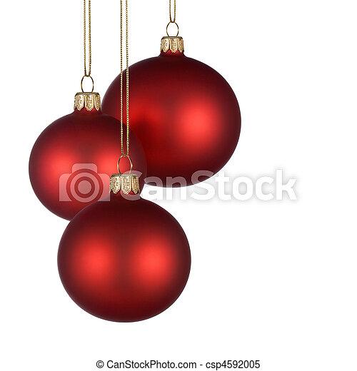 Un arreglo navideño con adornos rojos - csp4592005
