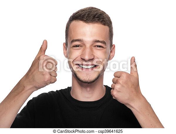 Hombre mostrando un pulgar arriba. - csp39641625