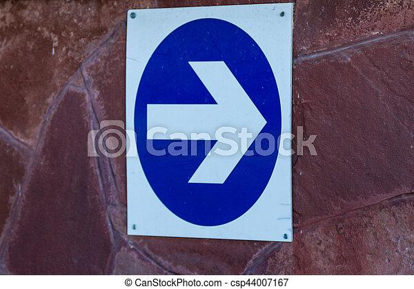 arrow on the wall - csp44007167