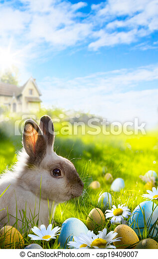 Art Colorful easter eggs and rabbit on green grass  - csp19409007