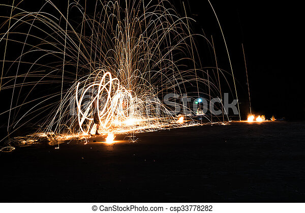 Art of fire show on the beach - csp33778282