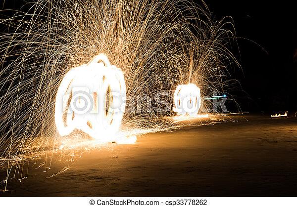 Art of fire show on the beach - csp33778262