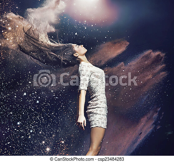 Art photo of the ballet dancer among colorful dust - csp23484283