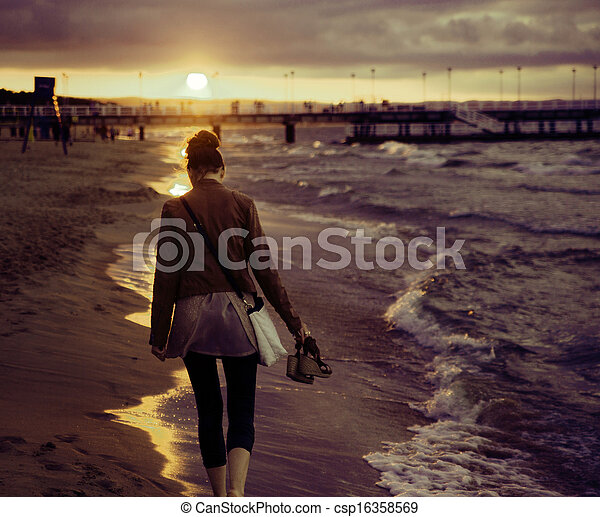Art picture of woman with the sunset in the background - csp16358569