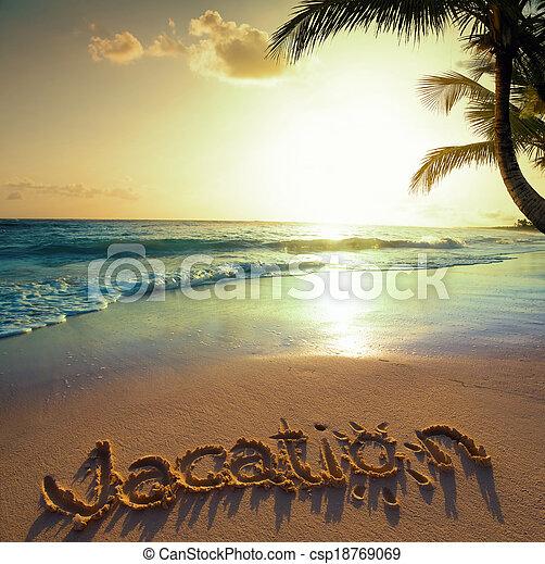 Art Summer vacation concept--vacation text on a sandy ocean beach  - csp18769069