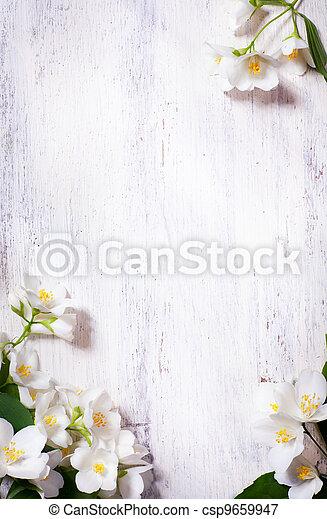 Un marco de flores de jazmín de arte en la madera vieja - csp9659947