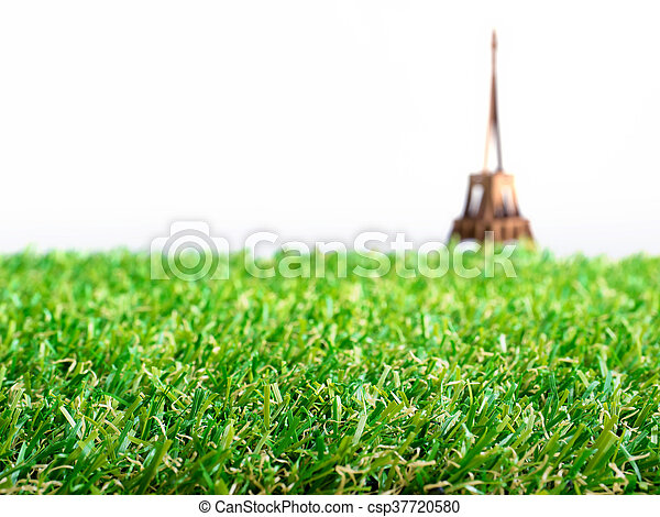 Artificial grass with blurry background of Eiffel tower paper model apply for Euro 2016 football tournament at France - csp37720580