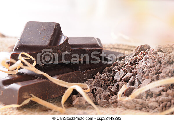 Artisan chocolate broken stack with portions and chunks close up - csp32449293