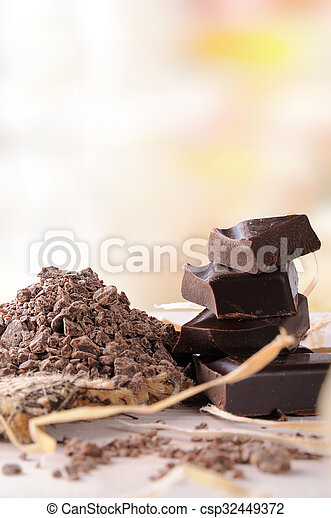 Artisan chocolate broken tablet stack with portions and chunks vertical - csp32449372