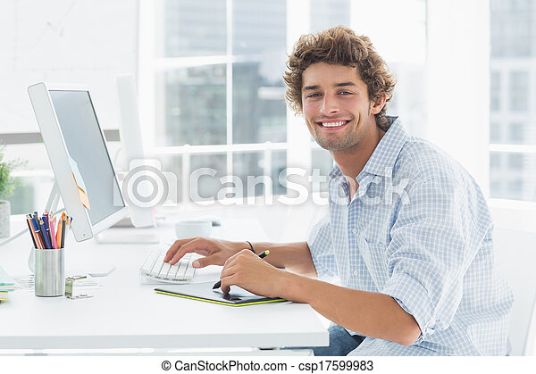 Artist drawing something on graphic tablet with pen - csp17599983
