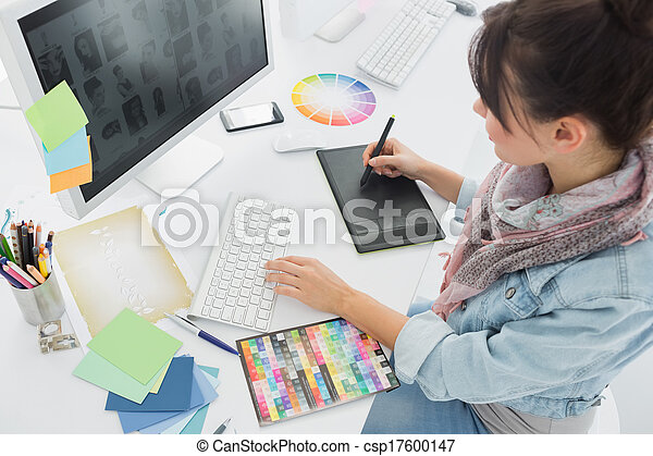 Artist drawing something on graphic tablet at office - csp17600147
