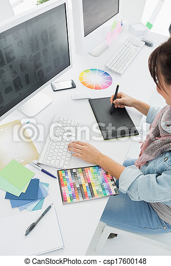 Artist drawing something on graphic tablet - csp17600148