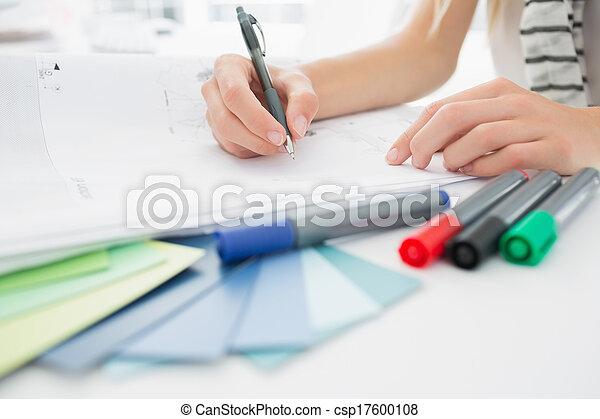 Artist drawing something on paper w - csp17600108
