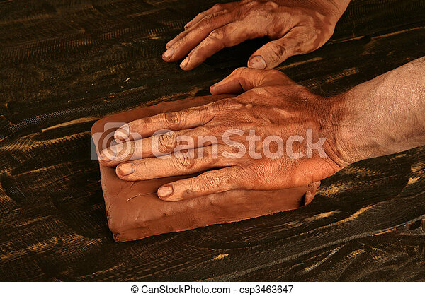 artist man hands working red clay for handcraft - csp3463647