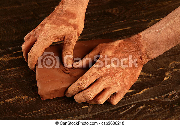 artist man hands working red clay for handcraft - csp3606218