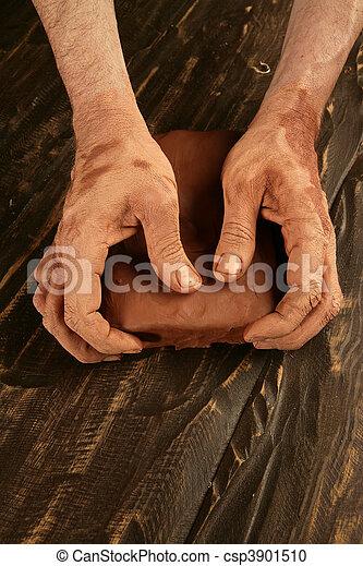 artist man hands working red clay for handcraft - csp3901510