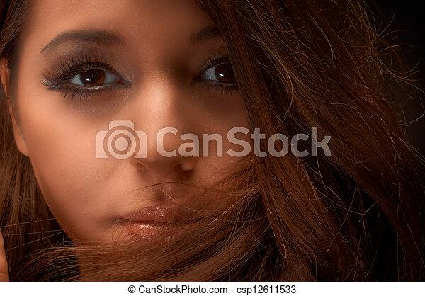 Artistic closeup photo of a young woman - csp12611533