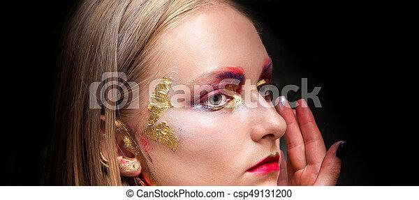 Artistic professional make up applies eye shadow. - csp49131200