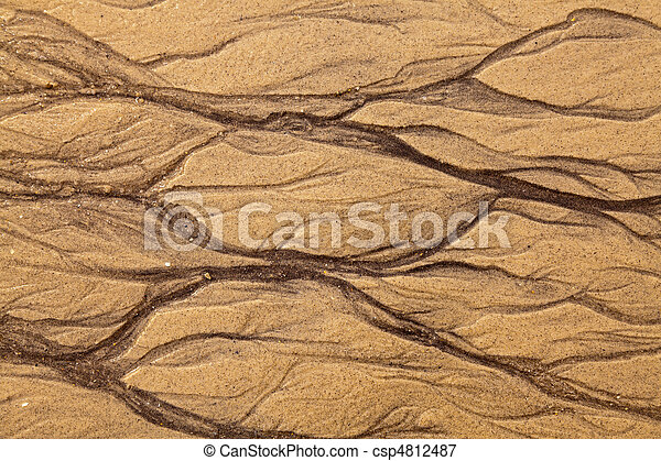Artistic shapes in the sand - csp4812487