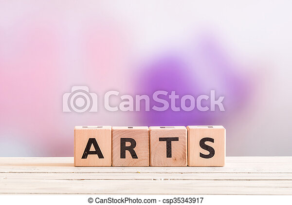 Arts sign on a wooden table - csp35343917