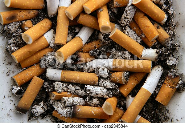 Ashtray full of cigarettes. Dirty tobacco texture - csp2345844