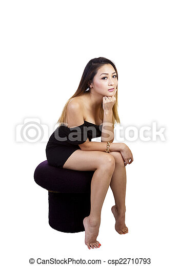 Asian American Woman Little Black Dress Sitting - csp22710793