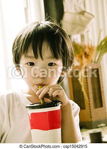 asian boy drinking ice green tea - csp15042915