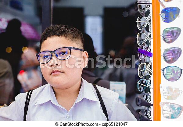 9bbc394b6dae Boy wearing glasses Stock Photos and Images. 7,172 Boy wearing glasses  pictures and royalty free photography available to search from thousands of  stock ...