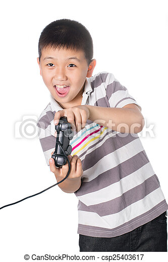 Asian boy with a joystick playing video games, isolated on white background - csp25403617