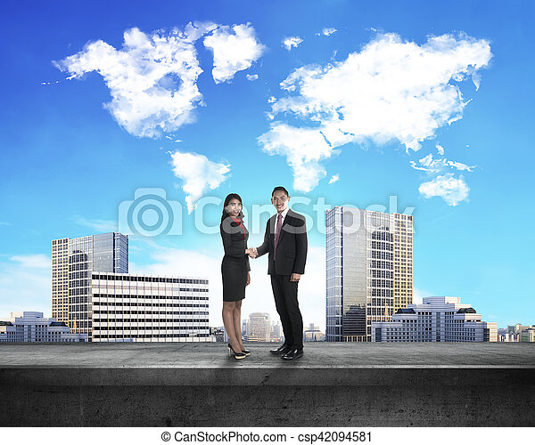 Asian business man and woman shaking hand - csp42094581