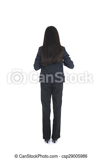 Asian business woman from the back looking at something isolated over white background - csp29005986