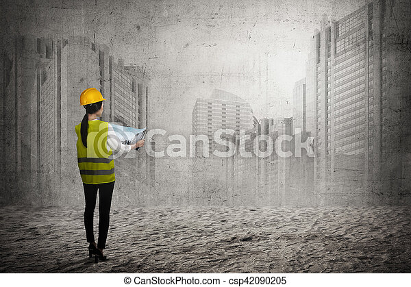 2776cc8a1f9 Asian Business Woman Wear Yellow Helmet Looking Blueprint To Build Office  Building